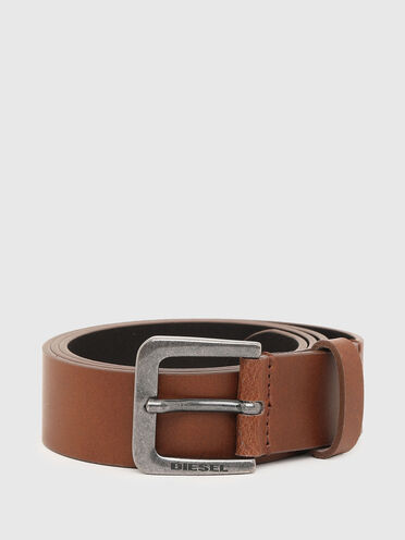 Leather belt with aged metal buckle