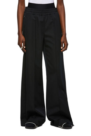 Compact pants with side slits