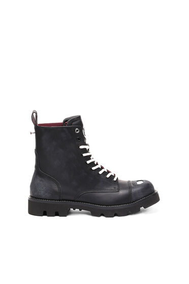 Combat boots with plaque detail
