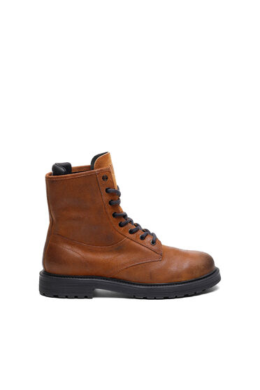 Combat boots in treated oiled suede