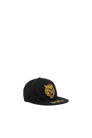 Baseball cap with embroidered patches