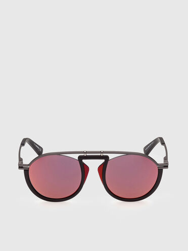 Pilot sunglasses with cut-outs between the structure and the lens