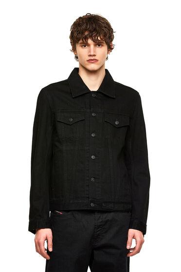 Trucker jacket in washed denim